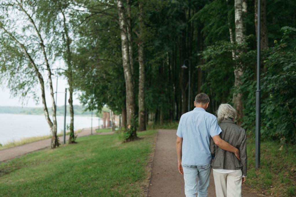 Elderly couple walking near water
